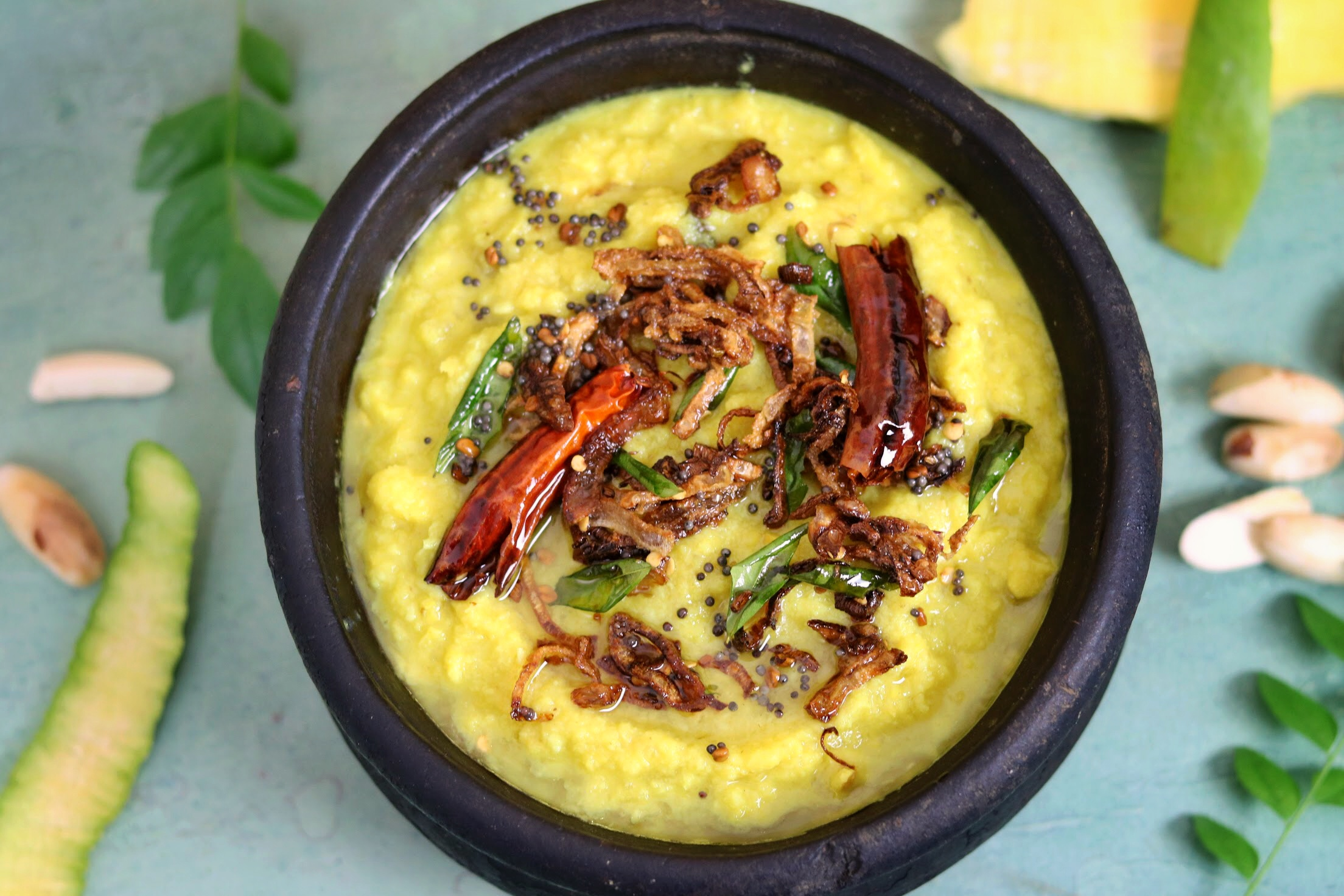 Jackfruit Seed Raw Mango Curry also known in Kerala as Chakkakuru Manga Curry