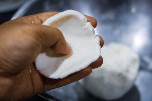 Rolling out the rice flour dough for making Kozhukatta Steamed Coconut Dumpling